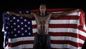 African Muscular Male Holding American Flag