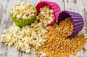 Pile Of Popcorn In Colorful Bowls