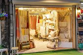 foto of boutique  - Bed linen boutique interior - JPG