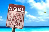 A Goal Without a Plan Is Just A Wish sign with a beach on background
