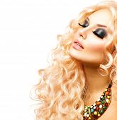 Glamour Blonde lady, Beauty model Girl With Healthy Long Curly Hair. Blond Woman Portrait. Wavy permed Hair, fashion make up and accessories