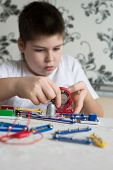 pic of pre-teen boy  - a Teen boy at home with electronic project - JPG