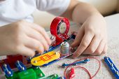 image of pre-teen boy  - a Teen boy at home with electronic project - JPG
