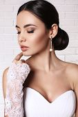 Beautiful Bride With Elegant Hairstyle Wearing Wedding Dress