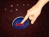 image of sos  - finger tap to the sos sign button on Universe background - JPG