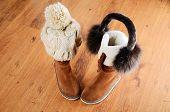 Winter Boots, Hat And Fur Headphones On The Floor Horizontal