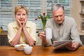 Senior couple spending the morning together at home in the kitchen