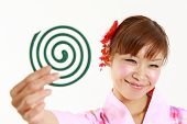 woman wearing Japanese kimono with mosquito coil