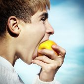 Teenager Eat An Apple
