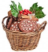 wicker basket full christmas cookie on a white background