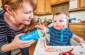 Woman Feeds Baby