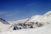 Ski Slope And Snowy Mountains In Sun Day