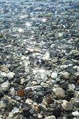 Gravel stones at the sea bottom near the coastline.