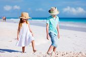 pic of brother sister  - Brother and sister at beach enjoying vacation - JPG