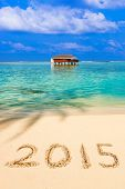 Numbers 2015 on beach - concept holiday background
