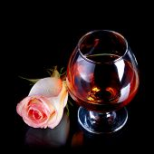 Glass With Alcohol And Rose.