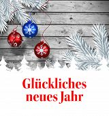 Gl�?�¼ckliches neues jahr against christmas baubles hanging over wood