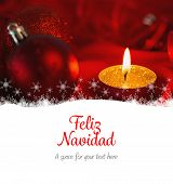 Feliz navidad against golden tea light candle with christmas decorations