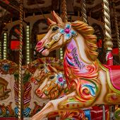 stock photo of paint horse  - Colourfully painted horses on a traditional carousel - JPG