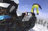 Photographed Snowboarder Jump With Smart Phone