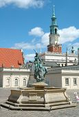 Fountain And Town Hall Tower On Marketplace In Poznan