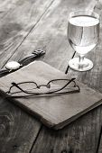 Writing Concept: Glasses, Notes, Glass Of Water