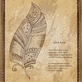 Artistically drawn, stylized, vector tribal graphic feather with hand drawn swirl doodle pattern. Gr