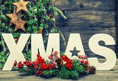 Christmas Decorations And Letter Xmas With Pine Tree Branches