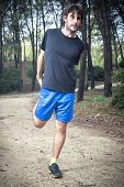 Male Athlete Doing Stretching Leg