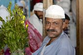 Man sells khat (Catha edulis) at the local market in Lahij, Yemen.