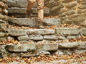 Unrecognizable Woman Walking Down The Stone Staircase