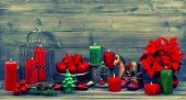 Christmas Decoration With Red Candles And Flower Poinsettia