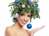 Christmas Winter Woman. Beautiful New Year and Christmas Tree Holiday Hairstyle and Make up.