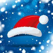 santa hat on blue winter background