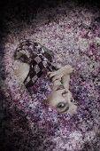 Woman lying in lilac
