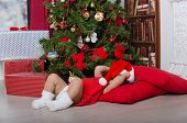 Small Santa Is Resting By Christmas Tree