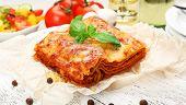 Portion of tasty lasagna on table