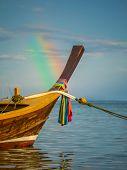 Long tailed boat Ruea Hang Yao in Phuket Thailand with rainbow