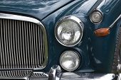 Closeup Of Chrome Grille And Lights Of Restored Classic Car