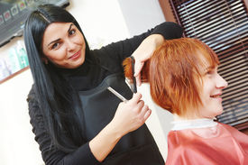 image of beauty parlour  - Stylist cutting hair of a female client at the beauty salon - JPG