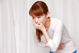 stock photo of vomiting  - concept shot of vomiting young Japanese woman - JPG