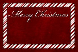 image of candy cane border  - A Merry Christmas card A Candy Cane border with words Merry Christmas over red plush background with copy - JPG