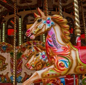 picture of carousel horse  - Colourfully painted horses on a traditional carousel - JPG