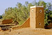 stock photo of middle eastern culture  - Photo of a Middle-Eastern Watchtower Made of Mud or Red Clay and Wall Ruins. ** Note: Soft Focus at 100%, best at smaller sizes - JPG