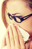image of blowing nose  - Sick young woman blowing her nose - JPG