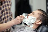 pic of barber  - Shaving the beard - JPG