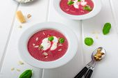 image of beet  - Soup from beet with light creame nuts and basil sprinkled organic beet - JPG