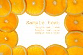 picture of valencia-orange  - frame made of sliced juicy oranges on white - JPG