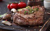 image of bbq food  - Beef rump steak on black stone table - JPG