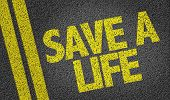 picture of blood drive  - Save a Life written on the road - JPG